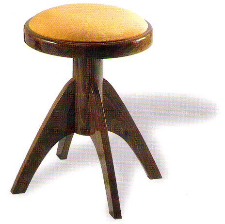 A Round Adjustable Piano Stool With Four Legs By Tozer